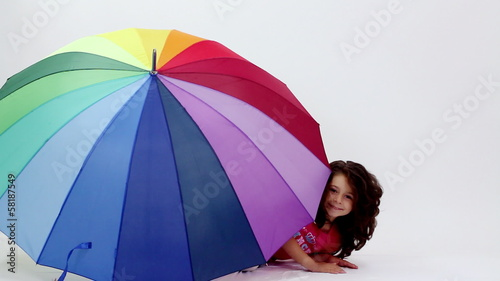 Young girl having fun with umbrella