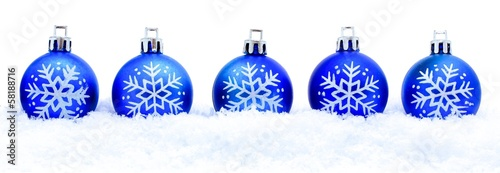 Border of blue Christmas baubles in fresh snow