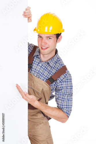 Male Worker Holding Blank Placard