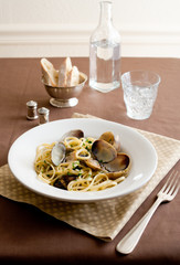 linguine with clams in a white wine sauce with parsley