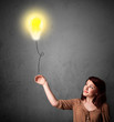 Woman holding a lightbulb balloon