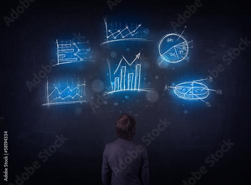 Businessman looking at glowing charts