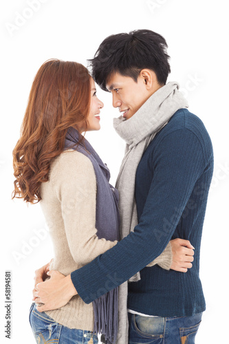 happy young couple hugging and looking