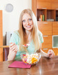 Positive  woman eating  fruit salad at home