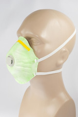plastic mannequin wearing Protective Dust Mask with valve
