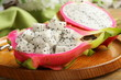 ripe sweet tropical dragon fruit on a wooden plate