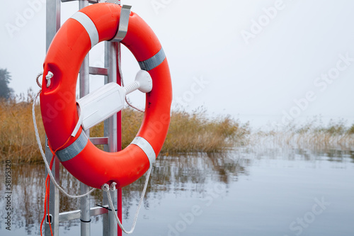 Safety equipment. Bright red safe lifebuoy