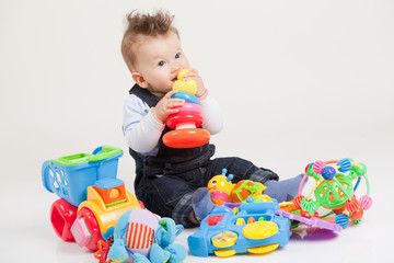 baby playing with toys white background