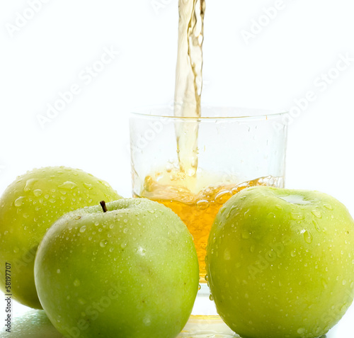 Apple juice with green apples on white background