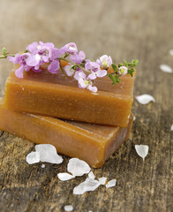 Spring blossom with handmade soap on wood background
