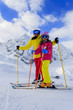Ski and fun  - family enjoying winter holidays
