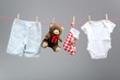 Baby boy clothes with santa bags  on the clothesline