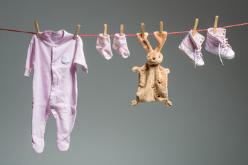 Clean baby girl clothes on the clothesline