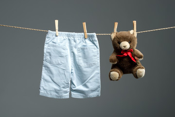 Baby boy pants, a teddy bear on the clothesline