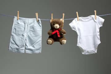 Baby boy clothes, a teddy bear on the clothesline