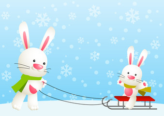 Cute white rabbits with sled