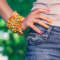 Colorful bracelet on a womans' hand