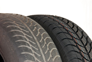 old and new winter car tires