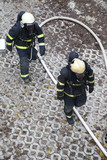 Two firefighters rush to rescue injured people