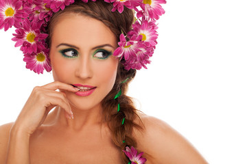 Young beautiful woman with flowers in hair