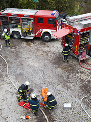 Fire departments and emergency response teams on drill