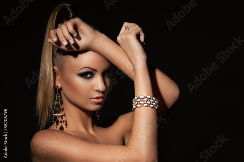 Beautiful model with ponytale and makeup