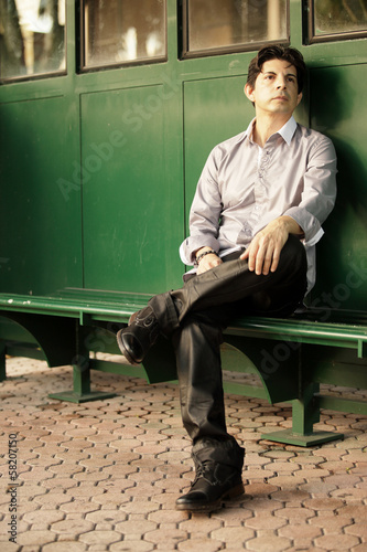 Stock image of a man waiting for the bus