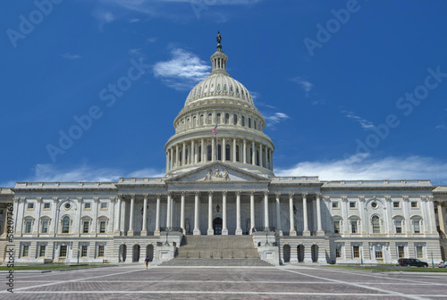 Washington Capitol on sunny cloudy sky background