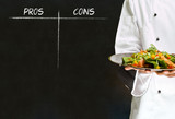 chef with chalk pros and cons on blackboard background