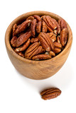 pecan nuts in a wooden bowl