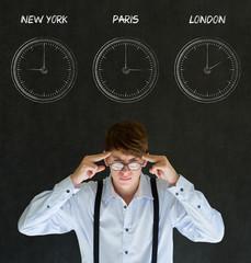 Businessman with chalk time zone clocks on blackboard background