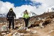 Couple walking and hiking in Himalaya Mountains