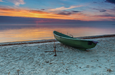 Lonely fishing boat at a sandy beach of the Baltic Sea