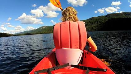 Young female kayaking, USA