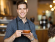 Happy Waiter Holding Coffee Cup In Cafeteria