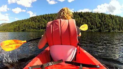 Ambitious adventurous female kayaking, USA
