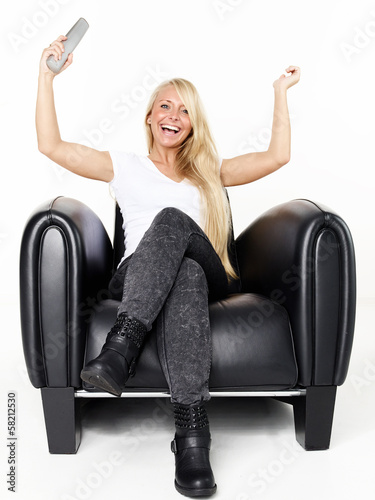 Woman with remote control is happy