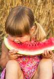Portrait of the child who eats sweet water-melon
