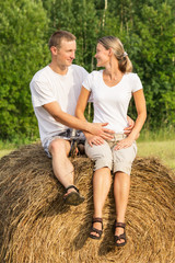 Two young lovers on haystack