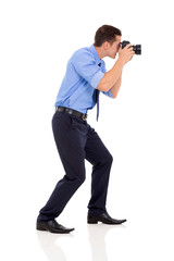 side view of male photographer shooting photos