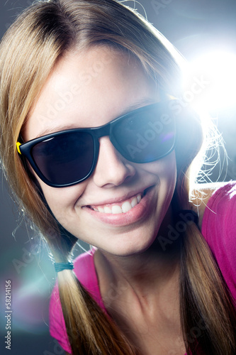 Happy young  woman with sunglasses looking at the camera