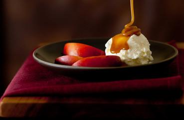 closeup of fruit with ice cream and caramel sauce