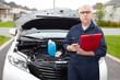 Auto mechanic checking engine.
