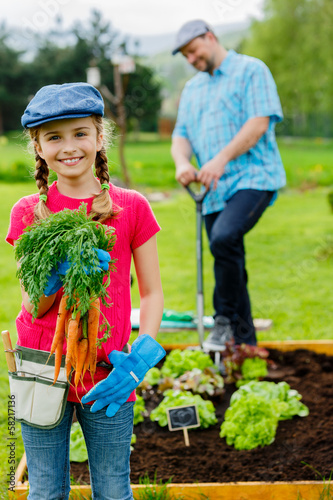 Garden, cultivation -  girl helping father in the garden