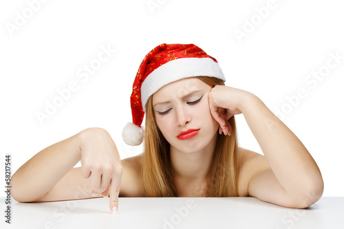 Young woman in santa claus hat posing isolated on white backgrou
