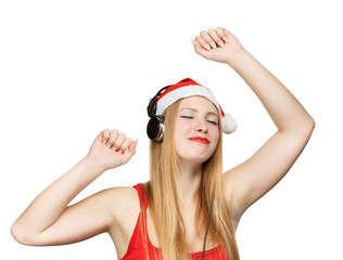 Young woman in santa claus hat and headphones take pleasure from