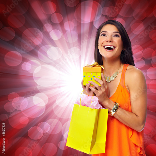 Woman with shopping bag and gift.