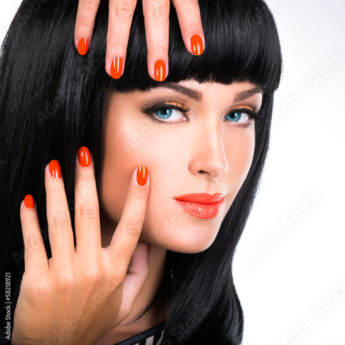 portrait of a woman with red nails and glamour makeup