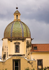 Dome of Church of Santa Maria Assunta, Italy with storm