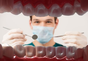View at young male dentist  from patient mouth